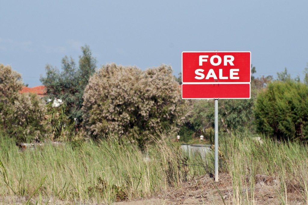 For sale sign on land