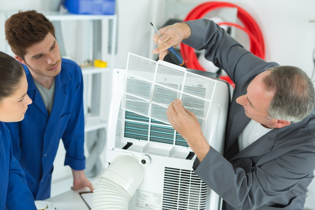 workers fixing aircon