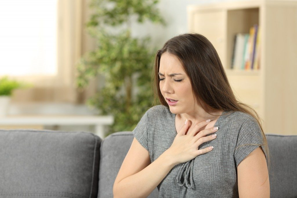 Woman finding it hard to breathe