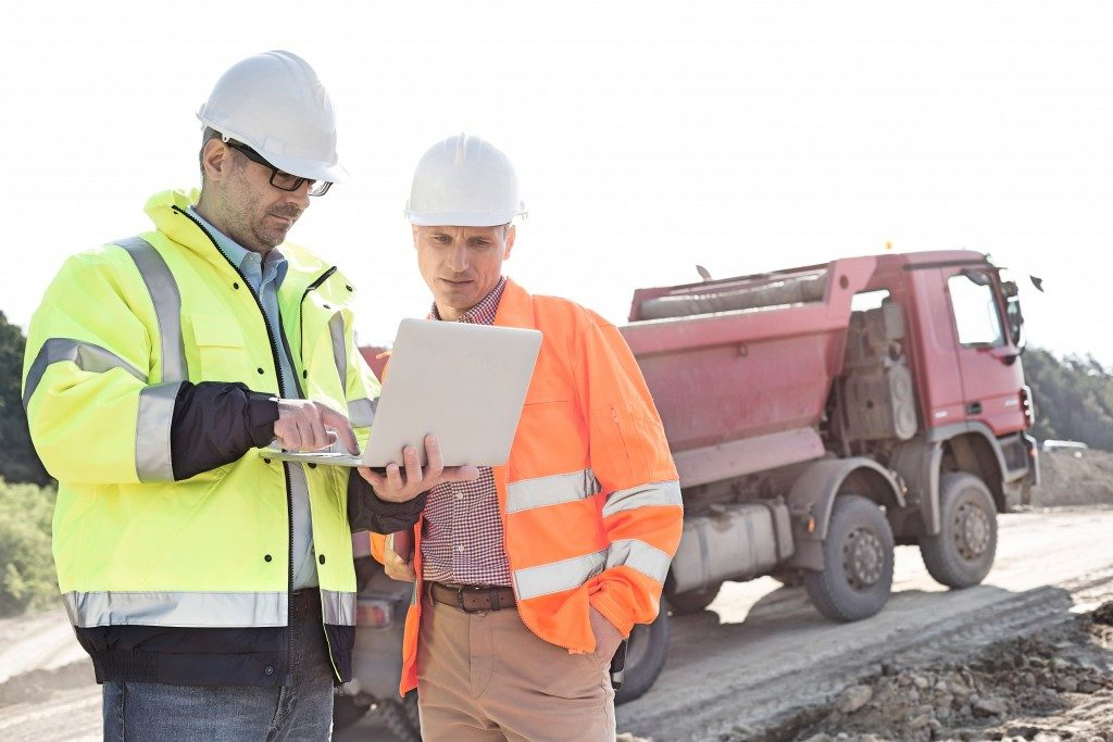 two men talking at a constuction site