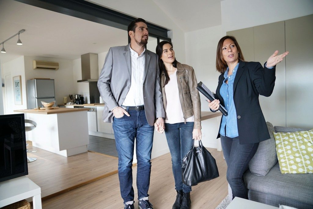 Agent touring the couple inside the house