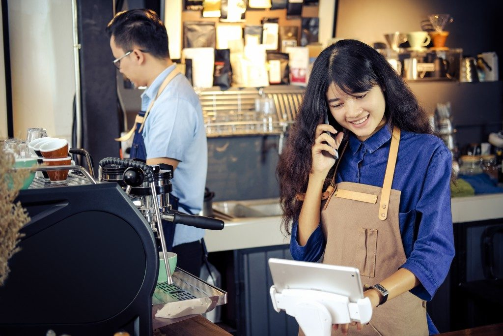 Baristas working in their shop