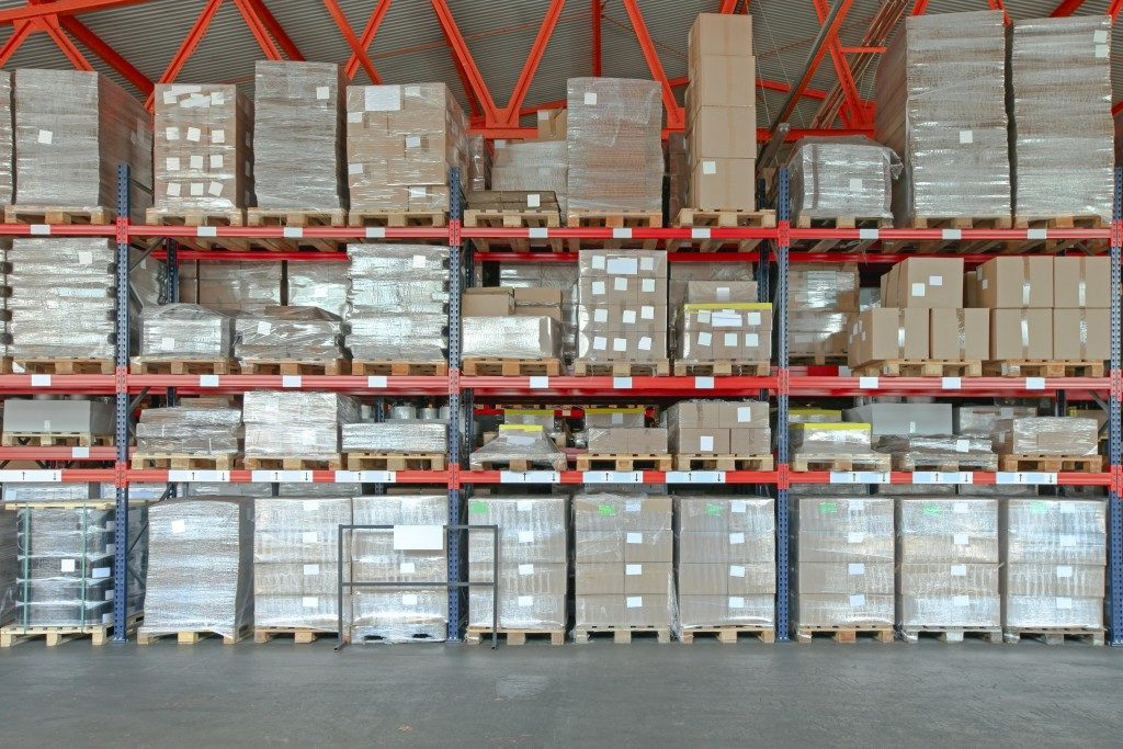 Shelving System With Boxes in Distribution Warehouse