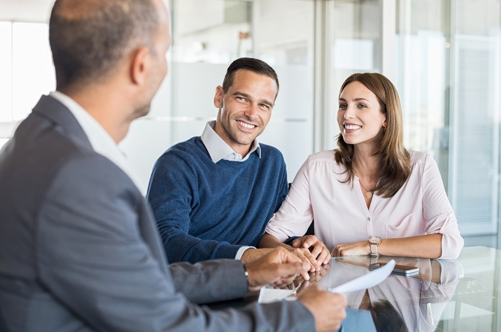 Financial adviser talking to a couple