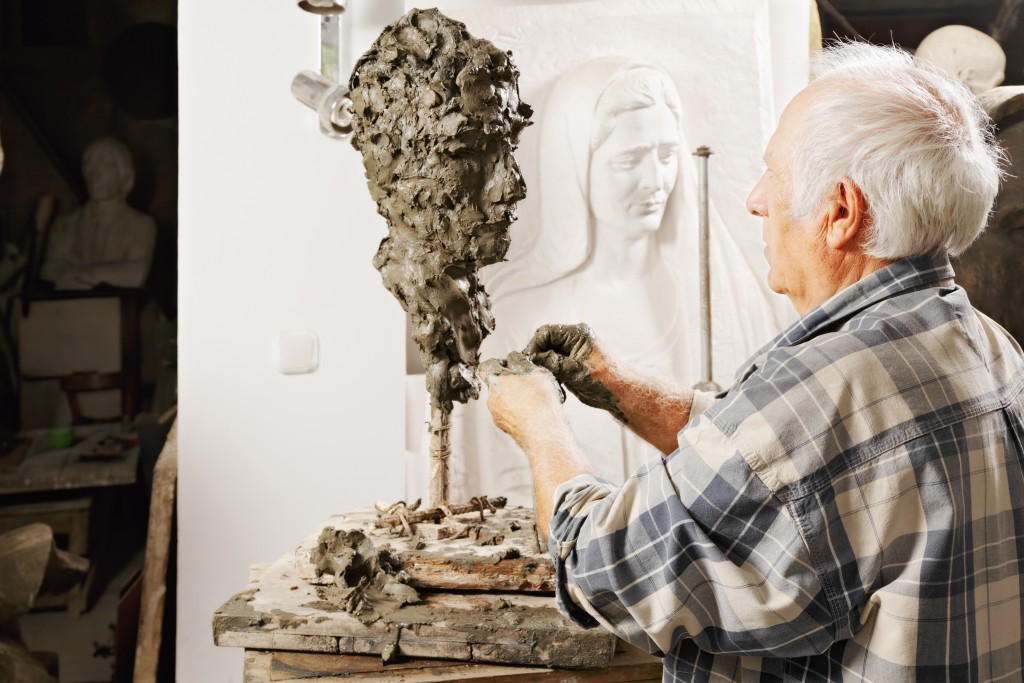 Man sculpting a bust