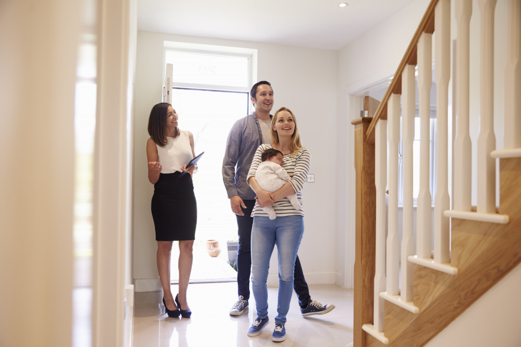 couple visiting a prospect house with their agent